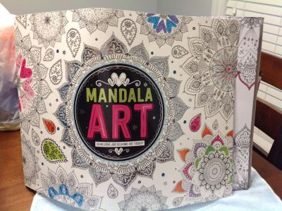 Mandala art book. 1 page started as shown in second picture.