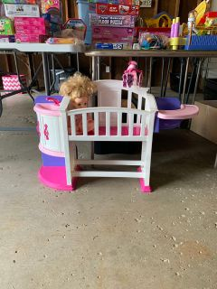 Toy baby crib with attached high chair and sink vanity. Asking 8.