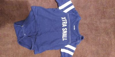 3 to 6 month Navy onesie with attached shirt.
