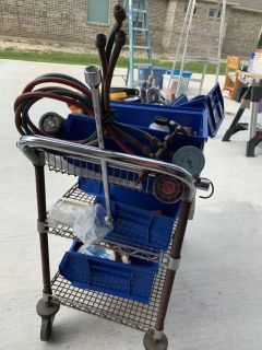 Cart full of tools and other items