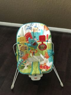 Fisher Price bouncer (vibrates, needs battery). Good condition, asking $10.00