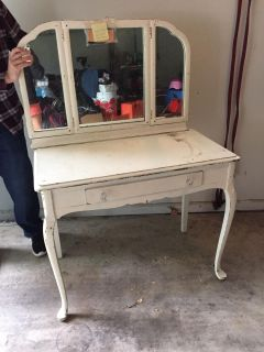 Vanity desk with mirrors that can fold in with drawer