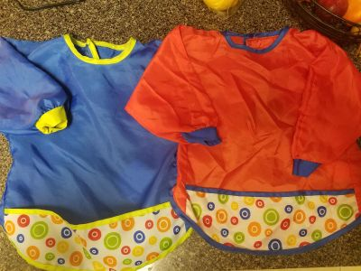 Ikea bibs. Great to keep clothes free of food or paint. $2 for both