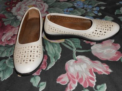 Size 8.5 slipons with beige designs around the cutouts
