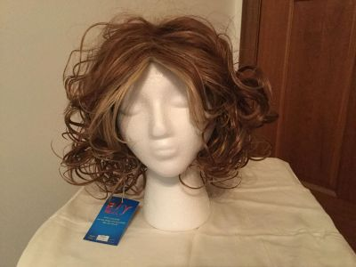 Wig adjustable. New with tag. Stand not included. Natural.