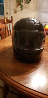 Motorcycle Helment with full face shield. Size Med.