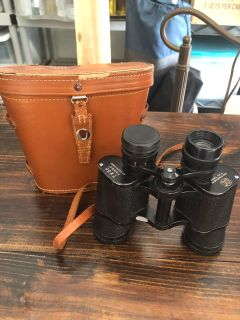 Antique binoculars and leather case