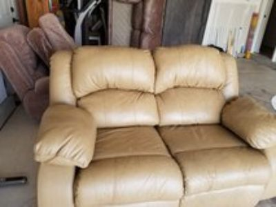 Tan leather loveseat recliner