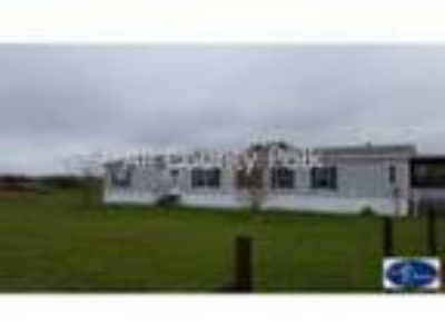 This Four BR . BA mobile home sits on acres in Polk