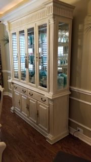 Beige China cabinet, dining table ,and 6 chairs