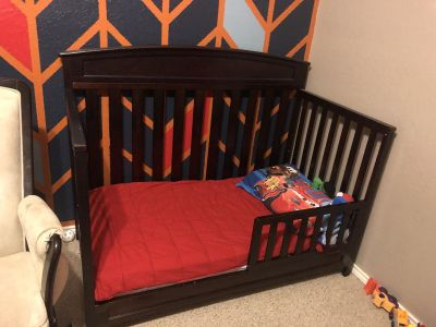 Baby crib with mattress and toddler bed conversion kit.