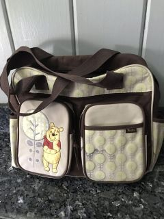 Winnie the Pooh diaper bag comes w/changing pad