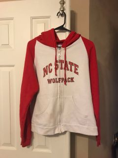 Women s medium NC State zip-up hoodie. Has some spots at bottom with some light staining but otherwise in great shape. Porch pickup.