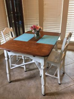 Table with extension. 3 chairs to match