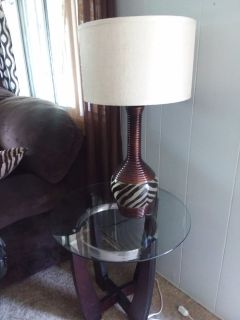 Chocolate overstuffed roind glass tables, matching lamps and area rug