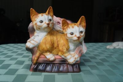 Ceramic cats on chair