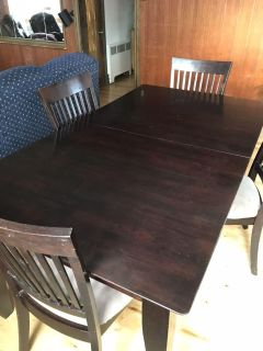 Beautiful wood kitchen table with insert. 6 chairs