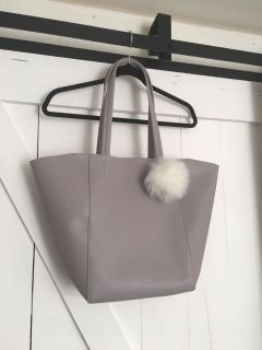 New and unused lavender tote with ball keychain