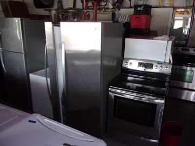 Kenmore Stainless Steel Refrigerator and Electric Stove