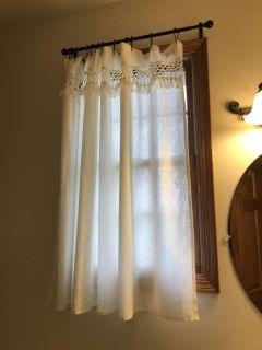 Cream colored window coverings/curtains
