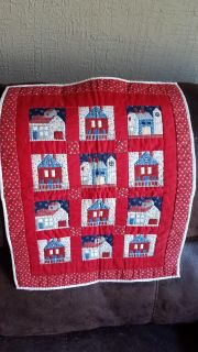 Quilted center piece with house design