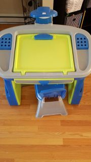 Plastic table and chair.