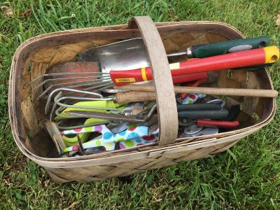 Basket of gardening tools. Some very old.