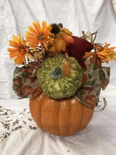 Cute fall arrangement with crackled pumpkin, has a few damaged spots that I turned to the wall