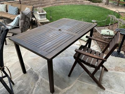 35.5x59 wood table and 4 fold up wood chairs