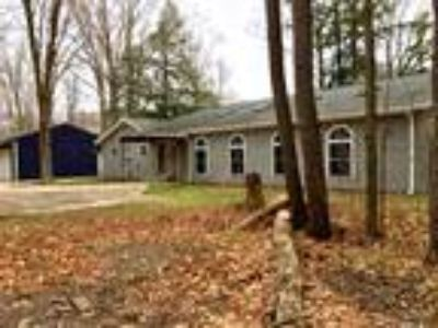 Online Auction - Three BR Muskegon River Home with Indoor Pool