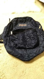 Navy blue. Nice condition. I don't see stains or wear