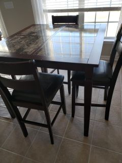 Counter height kitchen table and 4 chairs.