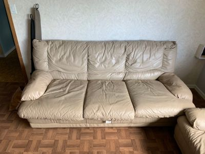 Guc Leather sofa bed and matching chair asking $150