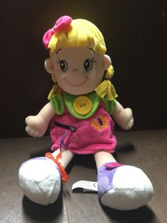 Doll, zipper, tie a shoe and Velcro.