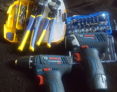 Bosch Lithium ion 12v impact driver with matching drill and misc bits and tool