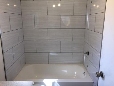 TILE SETTER-BATHROOMS-SHOWERS-FLOORING-TUBS-KITCHENS