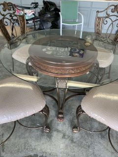Glass, wood and wrought iron table.