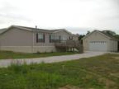 beautiful Three BR doublewide on large lot.