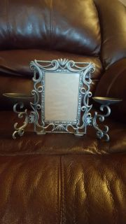 Pretty picture frame with candle holders
