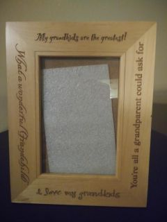 Beautiful wood picture frame. Show grandkids pride.