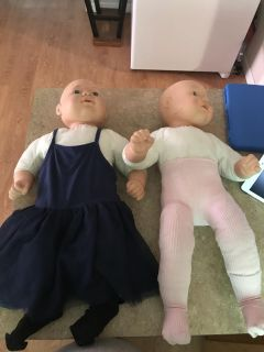 Two big baby s dolls asking $3 for both