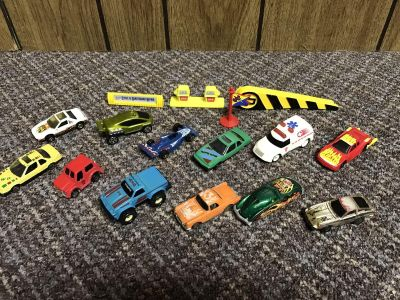 12 Match box cars 4 signs. $3.00 for all.