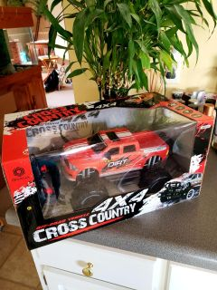 Brand New. Power Racing 4x4, Wheel Driven w/shock absorbers, Lights, Wireless Remote Control. Large- Measuring 13inL x 9inW