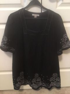 Darling Black Ladies Blouse With white trim in sleeves and bottom of shirt. Size Medium.