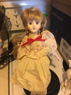 Porcelain doll with a doll stand