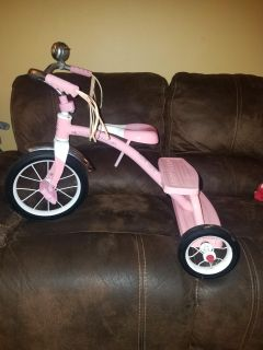 Pink Radio Flyer tricycle