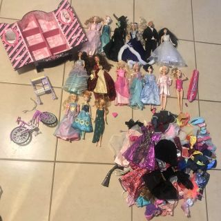 Lot of 16 Barbie Dolls and Accessories- Bike, Dolls, Wardrobe, Case, Clothes