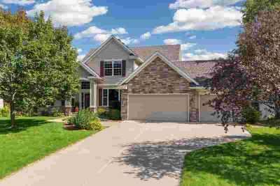 8067 Enclave Bay Woodbury Four BR, Stunning custom home in the
