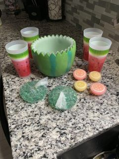 Watermelon cups and bowl with marbles and floating candles