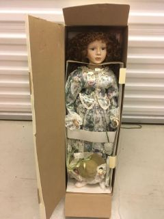 Large porcelain doll in box